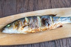 Grilled seabass on the wooden board Royalty Free Stock Images