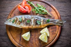 Grilled seabass on the wooden board Royalty Free Stock Image