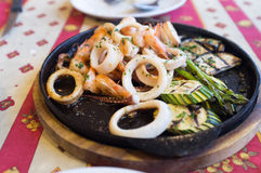 Grilled Seafood on Black Hot Plate royalty free stock photography
