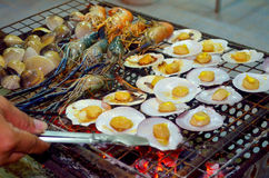 Grilled Seafood. Cooking seafood grilling The forces on the grill Royalty Free Stock Photo