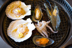Grilled seafood set with shrimp, squid, scallop Royalty Free Stock Image
