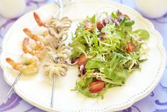 Grilled seafood on skewer and fresh salad Stock Photo