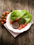 Grilled seitan with tomatoes Stock Photos
