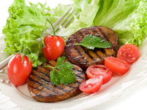Grilled seitan with tomatoes Stock Photo