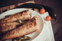 Grilled shad with tomato Stock Images