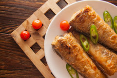 Grilled shad with tomato Stock Photo