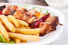 Grilled shashlik with chips Royalty Free Stock Photo