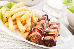 Grilled shashlik with french fries Stock Photography
