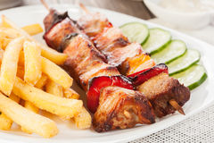Grilled shashlik with french fries Stock Images