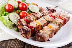 Grilled shashlik with vegetables Royalty Free Stock Images