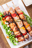 Grilled shashlik with vegetables Stock Photo