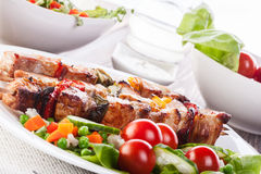Grilled shashlik with vegetables Stock Images