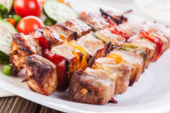 Grilled shashlik with vegetables Royalty Free Stock Images