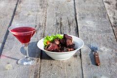 Grilled shashlik on white plate on wooden table Stock Image