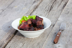 Grilled shashlik on white plate on wooden table Royalty Free Stock Photos