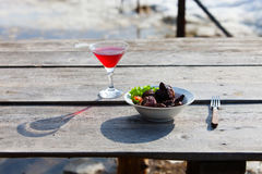 Grilled shashlik on white plate on wooden table Stock Photography