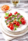 Grilled shashliks with vegetables and pork tenderloin royalty free stock photo