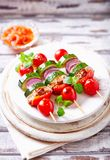 Grilled shashliks with vegetables and pork tenderloin. Grilled shashliks with pork tenderloin, cherry tomatoes, zucchini, red onion and red pepper. Home made royalty free stock photos