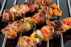 Grilled Shaslik Skewers On A Cooking Grate With Reflections On A Stock Photo
