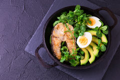 Grilled sheatfish fish steak with avocado, arugula and salad Stock Photography
