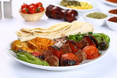 Grilled shish kebab with tomatoes on the skewers Royalty Free Stock Photos
