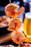 Grilled shrimp on bamboo skewers. Macro, closeup.  Stock Photo