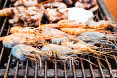Grilled shrimp on the flaming Stock Photo