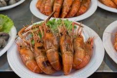 Grilled shrimp in foam dish at night market. Street food. Grilled shrimp in foam dish at Thailand night market. Street food Royalty Free Stock Photography