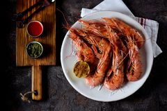 Grilled shrimp with garlic, soy sauce, olive oil, ginger and chili pepper. Top view. Stock Images