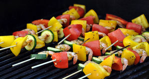 Grilled shrimp kebabs. Shrimp skewered on sticks with bell peppers and zucchini and cooked over a grill stock photo