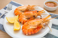 Grilled Shrimp and lemon on plate. Grilled Shrimp and lemon on white plate Stock Image