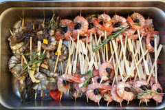 Grilled shrimp in a metal container Royalty Free Stock Images