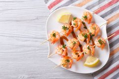 Grilled Shrimp On Skewers With Lemon Horizontal Top View Royalty Free Stock Images