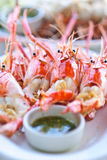 Grilled shrimp with seafood sauce. Colorful grilled shrimp with seafood sauce ready to be served stock photography