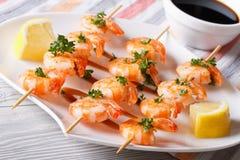 Grilled shrimp skewers closeup. horizontal Stock Images