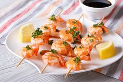 Grilled shrimp on skewers with lemon and sauce horizontal Stock Images