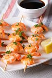 Grilled shrimp on skewers with lemon and sauce vertical Royalty Free Stock Photo