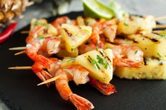 Grilled shrimp skewers with pineapple stock photo