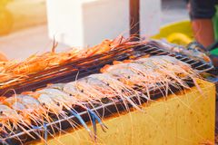 Grilled shrimp on stove with flame. Delicious seafood. royalty free stock images