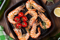 Grilled shrimps and beer Stock Images