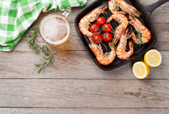Grilled shrimps and beer Stock Photography