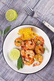 Grilled shrimps and corn garnished with lime and sage Royalty Free Stock Photos