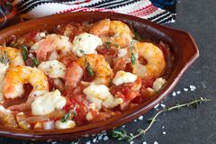 Grilled shrimps covered with feta cheese, tomatosauce Stock Photography