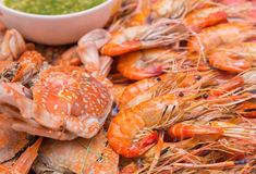 Grilled shrimps and crab on dish with seafood sauce Royalty Free Stock Photography