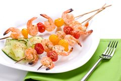 Grilled shrimps and cucumber s Stock Photography