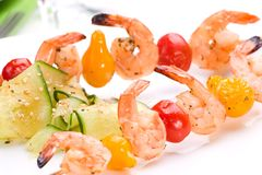 Grilled shrimps and cucumber s Stock Photos