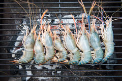 Grilled shrimps on the flaming grill, barbecue seafood Royalty Free Stock Images