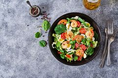 Grilled shrimps and fresh vegetable salad and egg. Grilled prawns. Healthy salad plate. Fresh seafood recipe. Grilled shrimps and fresh vegetable salad and egg Stock Photography