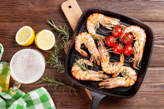Grilled shrimps on frying pan and beer Stock Image