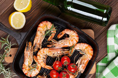 Grilled shrimps on frying pan and beer Royalty Free Stock Images